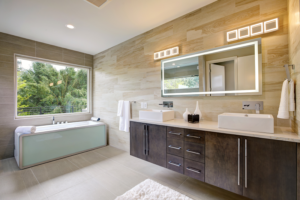 A modern bathroom with a tub and a spacious counter.