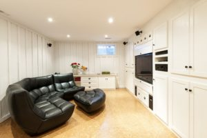 A finished basement with a home theater
