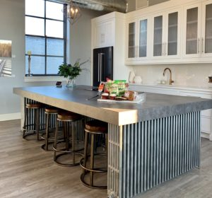 A large kitchen island in a cook's dream kitchen